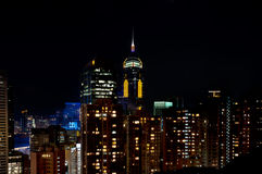 Środkowy placu Hong Kong drapacz chmur przy nocą Zdjęcia Stock