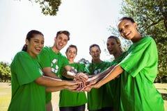 Środowiskowi aktywiści stawia ręki wpólnie Fotografia Royalty Free