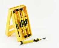 Śrubokręt w żółtym pakunku Obrazy Royalty Free