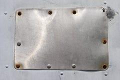 śrubujący kruszcowy talerz Zdjęcie Royalty Free