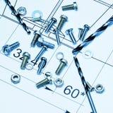 Śruby i świderów kawałki na rysunku prześcieradle Zdjęcie Stock