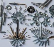 Śruby, rygle, gwoździe, dowels, nity, dokrętki, Fotografia Royalty Free