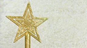 Świąteczna dekoraci zabawka na choinki złotej gwiazdzie Zdjęcia Stock