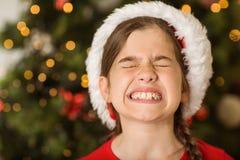 Świąteczna mała dziewczynka scrunching w górę jej twarzy Fotografia Royalty Free