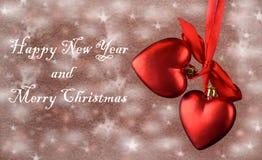 Świąteczna wystrój zabawka, czerwoni serca z łękiem Fotografia Stock