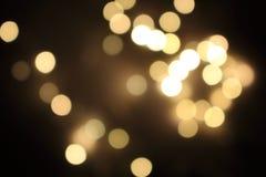 Świąteczni złoci zamazani światła Błyszczący bokeh abstrakcjonistyczni światła Rozjarzony skutka pojęcie Zdjęcia Stock
