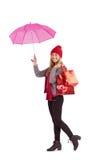 Świąteczny blondynki mienia parasol i torby Zdjęcie Stock