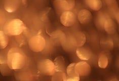 Świąteczny złocisty tło z bokeh skutkiem Fotografia Royalty Free