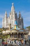 Świątynia i carousel na Tibidabo, Barcelona Zdjęcia Stock