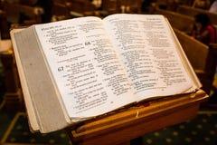Święte księgi przy kościelną ławką Fotografia Royalty Free