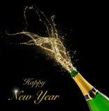 Świętowanie temat z chełbotanie szampanem dalej Fotografia Royalty Free