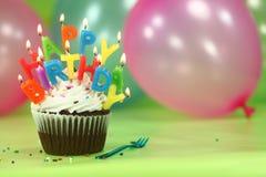 Świętowanie z balonu tortem i świeczkami Zdjęcia Royalty Free