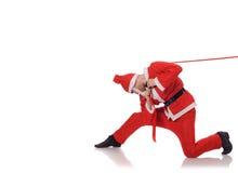 Święty Mikołaj ciągnienia czerwieni faborek Zdjęcia Royalty Free