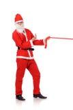 Święty Mikołaj ciągnienia czerwieni faborek Obraz Stock