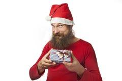 Święty Mikołaj daje prezentowi Zdjęcia Stock