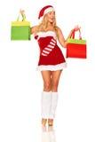 Święty Mikołaj dziewczyna z zakupami Zdjęcie Royalty Free