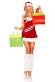 Święty Mikołaj dziewczyna z zakupami Fotografia Royalty Free