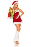 Święty Mikołaj dziewczyna z zakupami Fotografia Stock