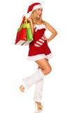 Święty Mikołaj dziewczyna z zakupami Zdjęcia Stock