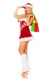 Święty Mikołaj dziewczyna z zakupami Zdjęcia Royalty Free