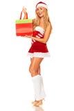 Święty Mikołaj dziewczyna z zakupami Obraz Stock