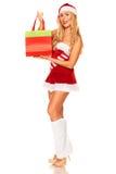 Święty Mikołaj dziewczyna z zakupami Zdjęcie Stock