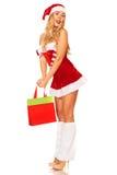 Święty Mikołaj dziewczyna z zakupami Obraz Royalty Free
