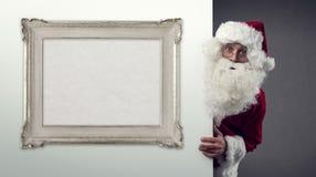 Święty Mikołaj i dekoracyjna rama Fotografia Stock