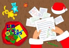 Święty Mikołaj i prezentów listy Zdjęcia Royalty Free
