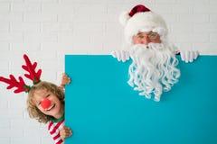 Święty Mikołaj i renifera dziecko Obrazy Royalty Free