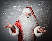 Święty Mikołaj i wiele życzenia Zdjęcie Stock