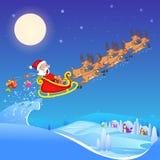 Święty Mikołaj jeździecki sanie ciągnący reniferem Fotografia Stock