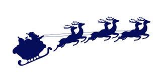 Święty Mikołaj jedzie w saniu ciągnącym reniferem Obraz Stock