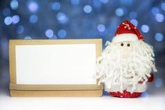 Święty Mikołaj lub ojciec Oszroniejący z białą pustą kartą Fotografia Stock