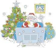 Święty Mikołaj ogląda TV Fotografia Royalty Free