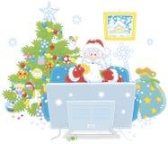Święty Mikołaj ogląda TV Zdjęcia Stock