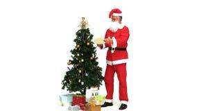 Święty Mikołaj patrzeje jego notatki zbiory