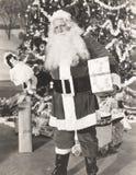 Święty Mikołaj pelengu prezenty Zdjęcia Royalty Free
