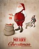 Święty Mikołaj przygotowywa prezenta kartka z pozdrowieniami Zdjęcie Royalty Free