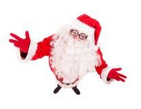 Święty Mikołaj rozprzestrzenia jego ręki szerokie Obrazy Royalty Free