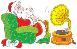 Święty Mikołaj słucha muzyka Obraz Royalty Free