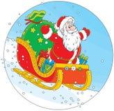 Święty Mikołaj sledding z prezentami Fotografia Royalty Free