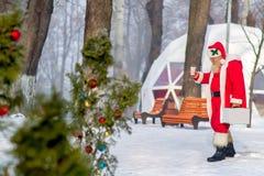 Święty Mikołaj spacer w parku Obraz Stock