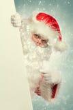 Święty Mikołaj w śnieżny wskazywać Obraz Stock