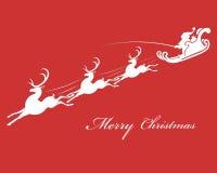 Święty Mikołaj w saniu z reniferem Fotografia Royalty Free