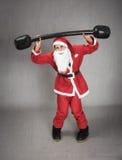 Święty Mikołaj w sprawność fizyczna momencie Zdjęcie Royalty Free