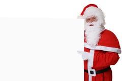 Święty Mikołaj wskazuje na bożych narodzeniach przy pustymi sztandarów copys z kapeluszem Zdjęcie Stock