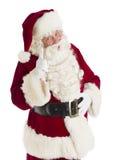 Święty Mikołaj Wskazuje Przeciw Białemu tłu Zdjęcia Stock