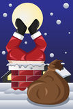 Święty Mikołaj wtykał w kominie Fotografia Royalty Free