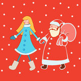 Święty Mikołaj z śnieżną dziewczyną w jaskrawym odziewa obraz stock
